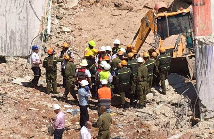 Scene of building collapse in Tel Aviv's Ramat Hachayal neigbourhood. (photo credit: IDF SPOKESMAN'S UNIT)