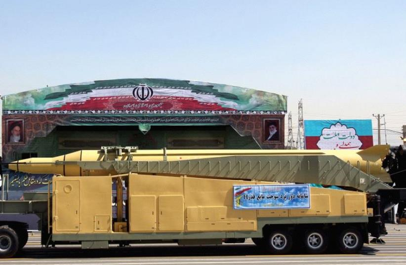 AN IRANIAN 'peace' missile on display during a 2015 parade overseen by Ayatollah Khamanei (photo credit: REUTERS)