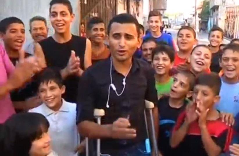 Former Hamas guard Adel Meshoukhi (photo credit: SCREENSHOT/REUTERS)