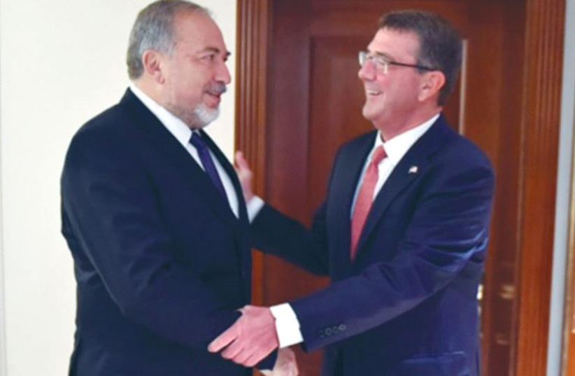 DEFENSE MINISTER Avigdor Liberman meets his US counterpart in London on Wednesday. (photo credit: ARIEL HERMONI / DEFENSE MINISTRY)