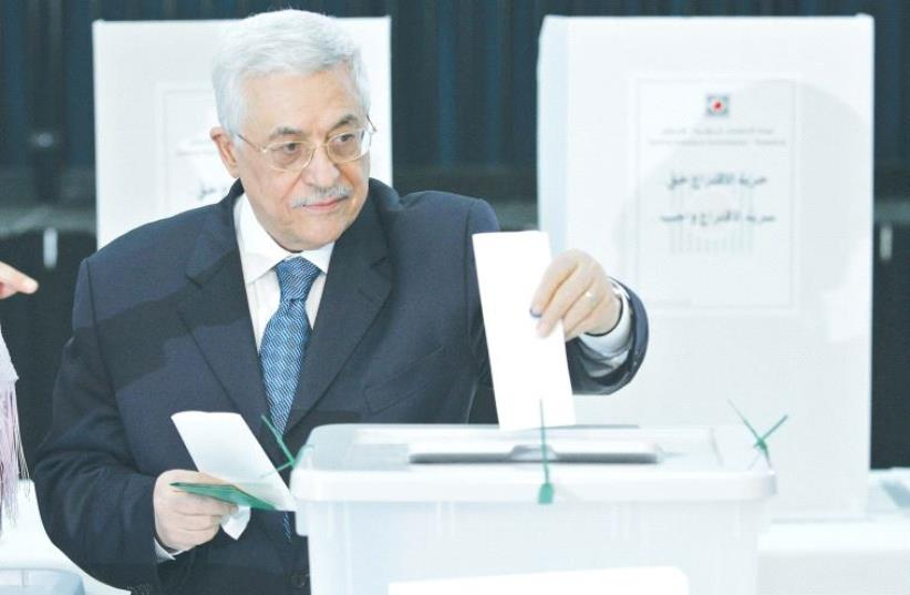 alestinian Authority President Mahmoud Abbas casts his vote at PA headquarters in Ramallah in 2005 (photo credit: REUTERS)
