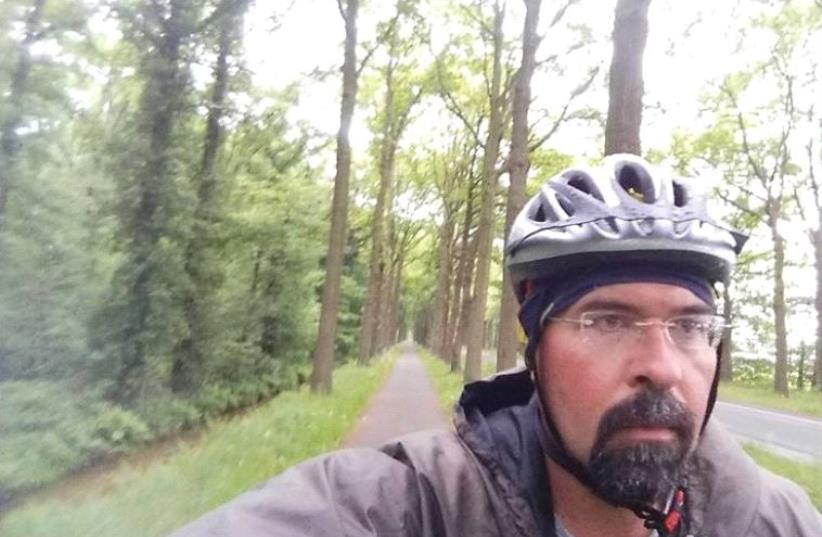 Keeping active, John Daly pedals long distances over difficult European roads to help raise funds for orphans in Nepal (photo credit: RONY R. BOONEN)