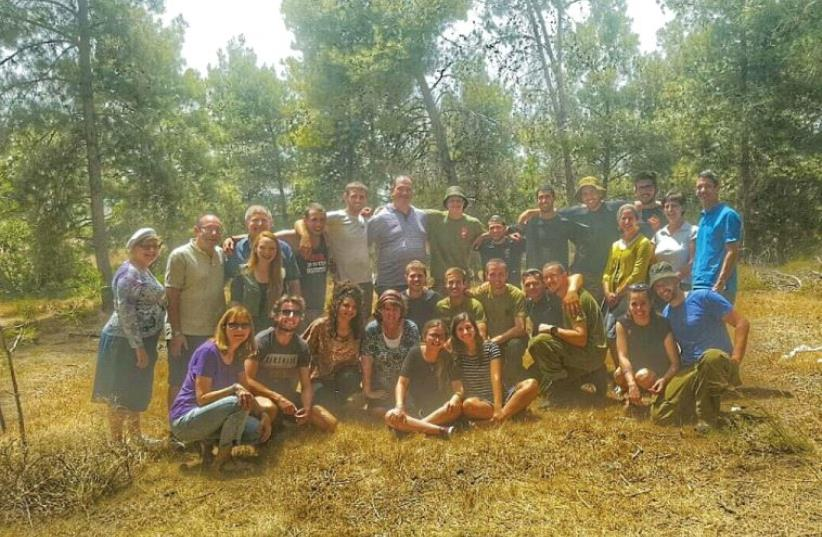 The 12 soldiers who live in the Beit Shemesh Lone Soldiers' Home with the counselors, board members and spouses on a fun day out (photo credit: Courtesy)