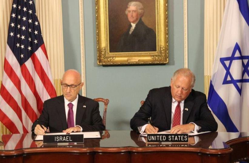 Yaakov Nagel and Thomas A. Shannon sign the 10-year defense agreement (photo credit: ISRAELI EMBASSY IN WASHINGTON)