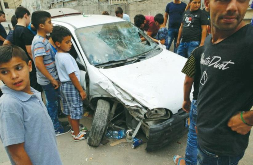 BORDER POLICE fired on this car in the capital's Shuafat refugee camp on September 5, killing the passenger, Mustafa Nimir, and wounding the driver, his cousin Ali Nimir. (photo credit: REUTERS)