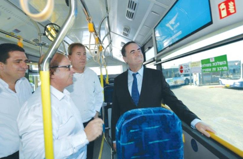 TRANSPORTATION MINISTER Israel Katz takes a ride yesterday in one of Tel Aviv's new Dan electric buses. (photo credit: DAN)
