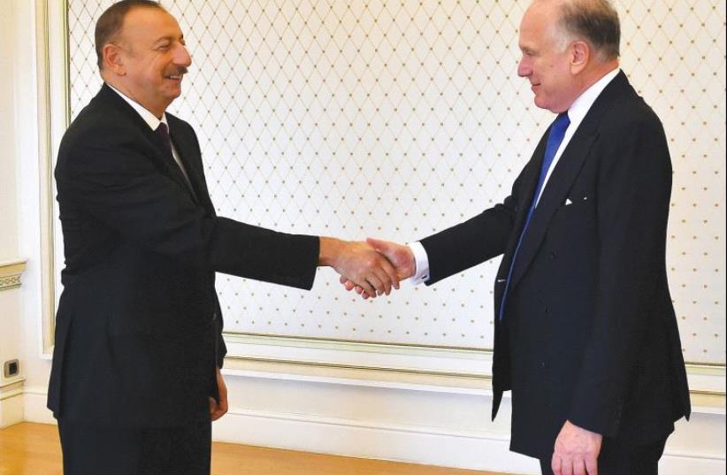 PRESIDENT ILHAM ALIYEV of Azerbaijan (left) welcomes WJC president Ronald S. Lauder. (photo credit: Courtesy)
