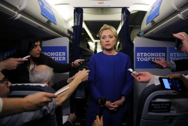 Democratic nominee Hillary Clinton talks to reporters about the explosion in Chelsea neighborhood of Manhattan, New York, as she arrives at the Westchester County airport in White Plains, U.S., September 17, 2016 (photo credit: REUTERS)