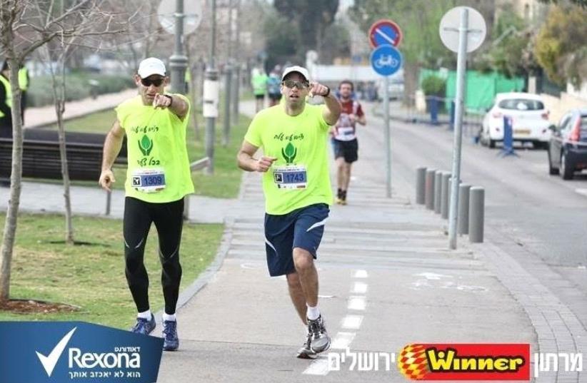 Jason Gardner (left) runs the 2015 Jerusalem Marathon with an ALEH Ascend teammate. (photo credit: Courtesy)