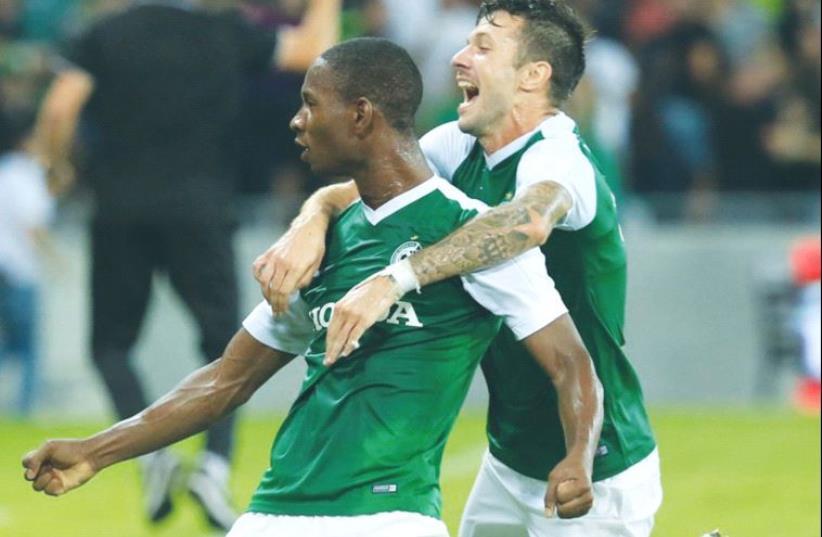 Maccabi Haifa striker Glynor Plet (left) celebrates with teammate Nikita Rukavytsya after scoring the winner in last night's 2-1 victory over Hapoel Beersheba at Haifa Stadium. (photo credit: ERAN LUF)