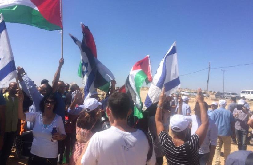 Right-wing activists and Palestinians clash at Sussiya. (photo credit: Courtesy)