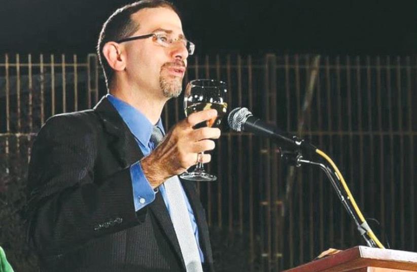 US AMBASSADOR Dan Shapiro toasts the New Year. (photo credit: FACEBOOK)