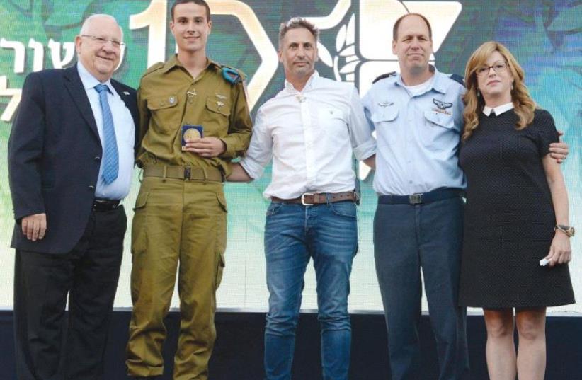 ATTENDING AN EVENT at the President's Residence on Monday are, from left, President Reuven Rivlin, Omer Ben Horin, Erez Raslevsky, Hagai Topolanski and Bracha Zisser. (photo credit: MARK NEYMAN / GPO)