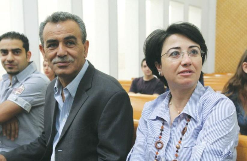 MK HANEEN ZOABI (right) sits with MK Jamal Zahalka at the Supreme Court in Jerusalem in May 2012. (photo credit: MARC ISRAEL SELLEM/THE JERUSALEM POST)