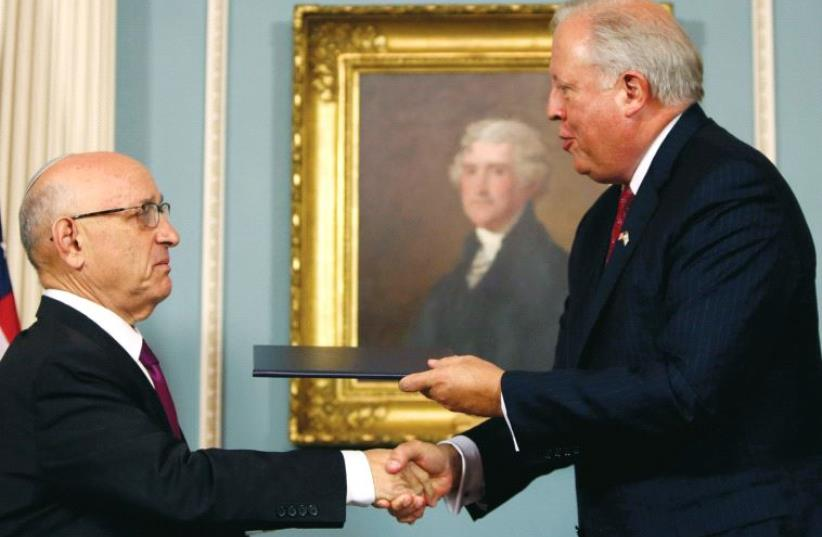 US Undersecretary of State Tom Shannon (R) and Israeli Acting National Security Advisor Jacob Nagel (L) shake hands after participating in a signing ceremony for a new ten year pact on security assistance between the two countries, in Washington (photo credit: REUTERS)