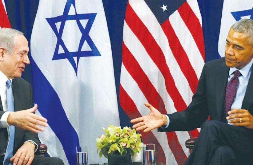 A SMILING Prime Minister Benjamin Netanyahu reaches out to shake the hand of an aloof President Barack Obama during their meeting Wednesday in New York. (photo credit: REUTERS)
