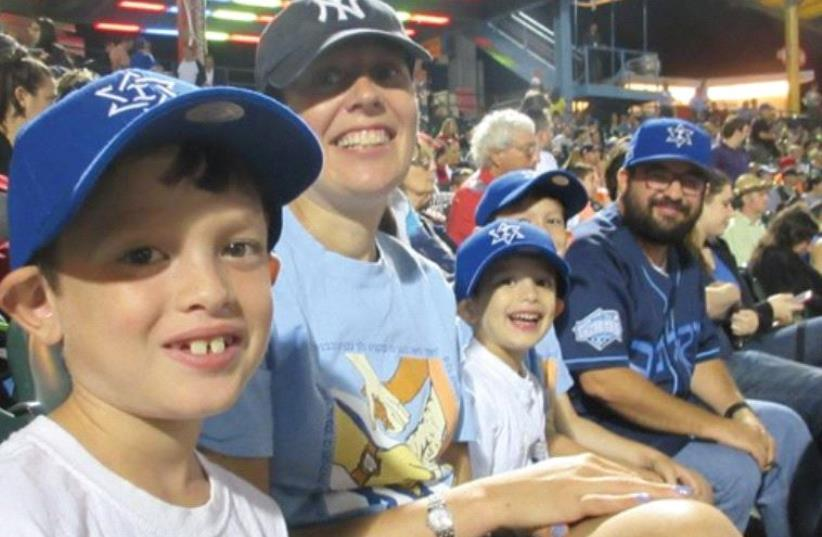 The Posner Family enjoying Team Israel's Thursday night victory over Great Britain at the World Basel Classic in Brooklyn. (photo credit: HOWARD BLAS)