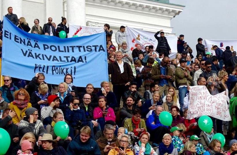 Protesters take part in a demonstration against racism and far right movements in downtown Helsinki, Finland, September 24, 2016 (photo credit: REUTERS)