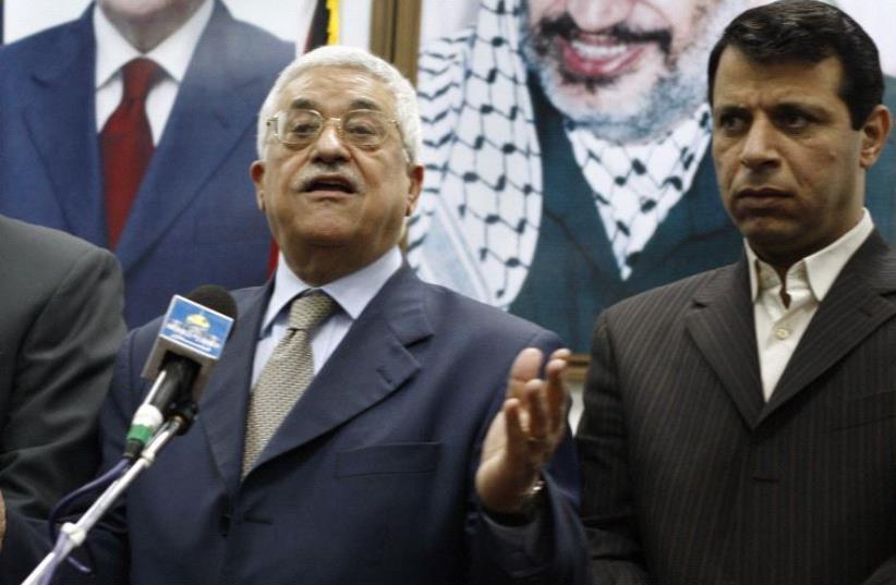 Palestinian President Mahmoud Abbas and Muhammed Dahlan (right) (photo credit: REUTERS)