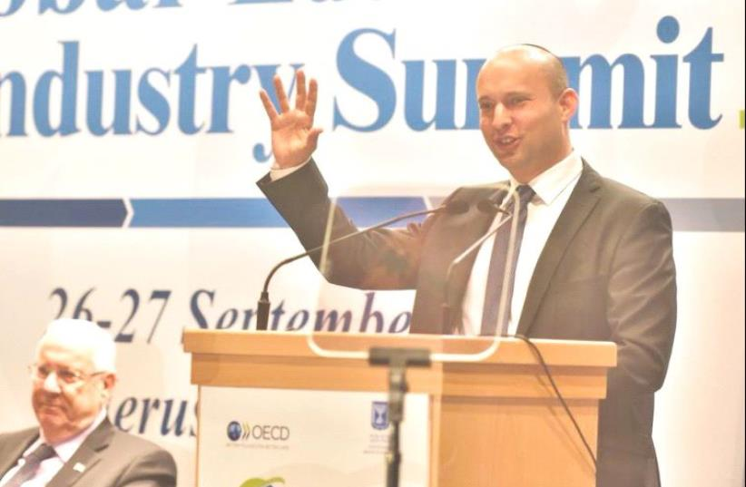 EDUCATION MINISTER Naftali Bennett speaks at the OECD global summit in Jerusalem yesterday as President Reuven Rivlin looks on. (photo credit: Courtesy)