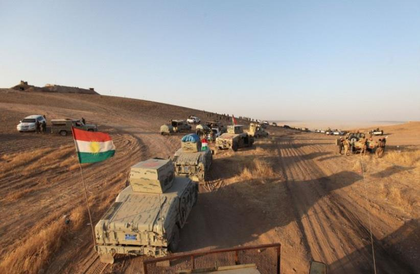 Kurdish Peshmerga forces are seen southeast of Mosul, August 14 (photo credit: REUTERS)
