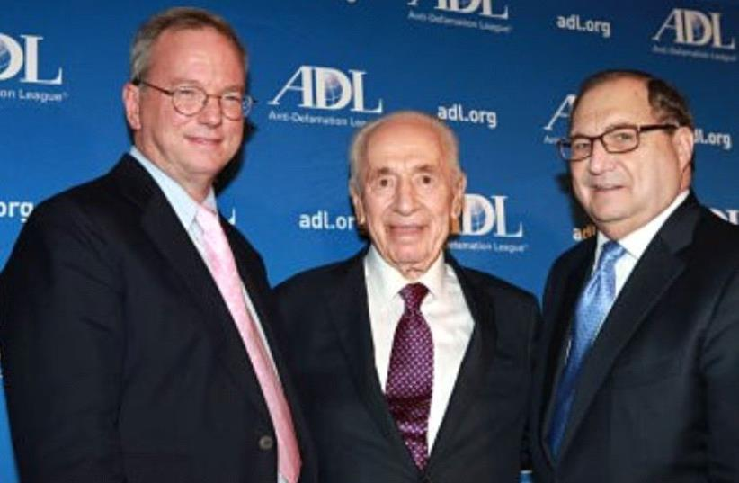 Former ADL national director Abraham H. Foxman presented two of ADL's top awards to Shimon Peres, the ninth president of the State of Israel, and Eric Schmidt, former executive chairman of Google. (photo credit: ADL)