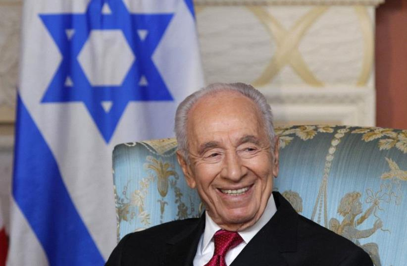 Shimon Peres takes part in a meeting in Ottawa, May 2012 (photo credit: REUTERS)