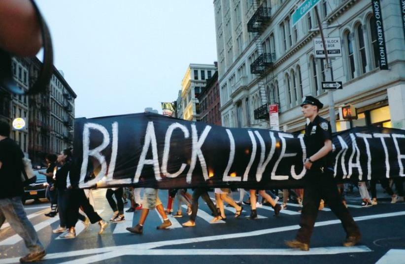 People take part in a protest against police brutality and in support of Black Lives Matter during a march in New York (photo credit: REUTERS)