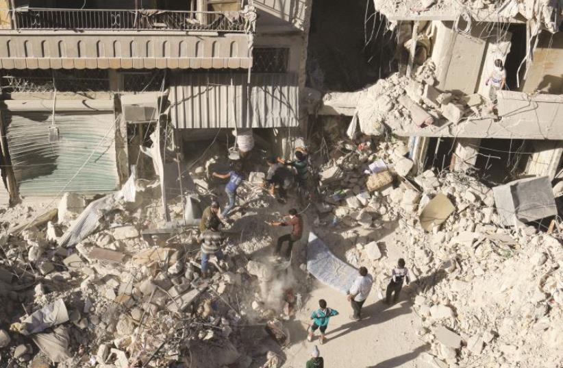 Après les bombardements sur Alep, le 27 septembre (photo credit: REUTERS)