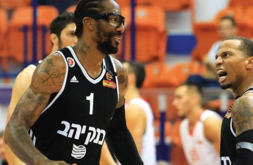 Hapoel Jerusalem center Amar'e Stoudemire (left) had 10 points on his debut on Israeli soil yesterday, helping his team to a 93-81 win over Maccabi Rishon Lezion in the semifinals of the preseason Winner Cup in Nahariya. (photo credit: ERAN LUF)