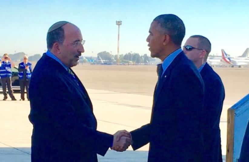 US President Barack Obama greeted by Dore Gold as he lands at Ben Gurion Airport (photo credit: FOREIGN MINISTRY)