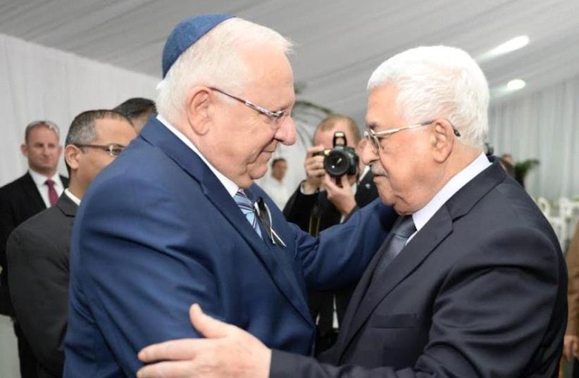 President Rivlin with PA President Abbas (photo credit: Mark Neiman/GPO)