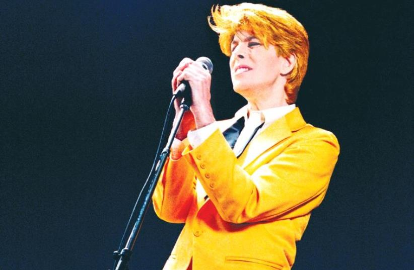 BOWIEMANIA: Since 2000, David Brighton has adopted the look, feel and sound of the late rock legend. (photo credit: Courtesy)