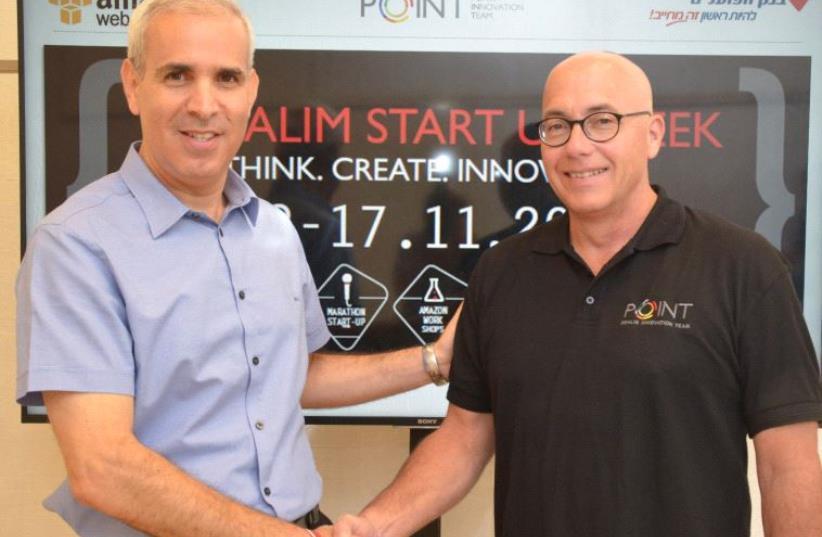 AVI KOCHVA, director of the Innovation Division and Deputy CEO at Bank Hapoalim and Harel Ifhar, general manager of Amazon Web Services Israel. (photo credit: BANK HAPOALIM)
