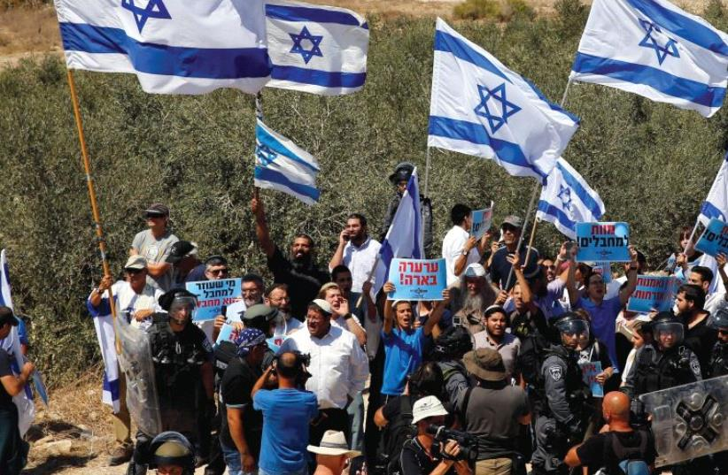 'WHAT IS a Zionist? A Zionist is someone who believes in and works for the existence of a democratic nation state for the Jewish people.' (photo credit: REUTERS)