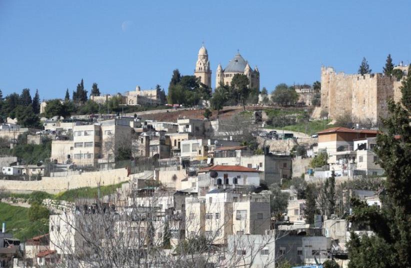 Homes in the eastern Jerusalem neighborhood of Silwan, pictured above (photo credit: MARC ISRAEL SELLEM)