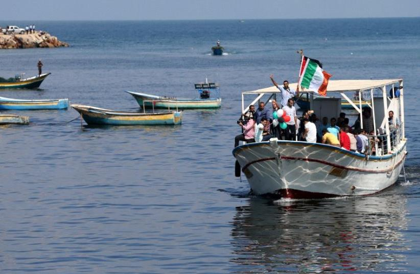 Palestinians ride a boat as they take part in a rally to show solidarity with Gaza-bound flotilla October 5, 2016. (photo credit: REUTERS)