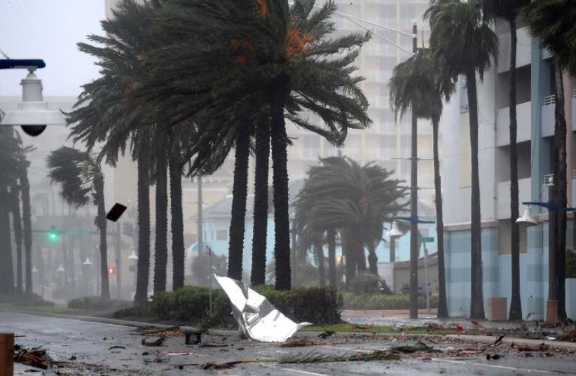 Debris flies through the air as the eye of Hurricane Matthew nears Daytona Beach, Florida. (photo credit: REUTERS)