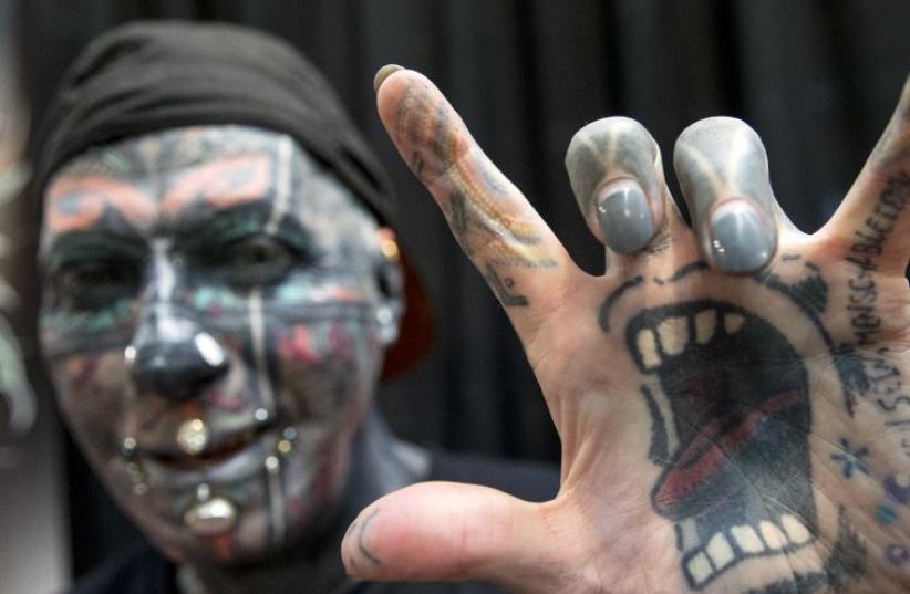 Third Annual Tel Aviv Tattoo Convention (photo credit: JACK GUEZ / AFP)