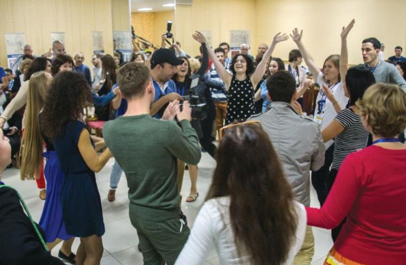 Having fun at a pre-Shabbat gathering at the annual Limmud FSU Kazan Volga- Urals region conference (photo credit: SARAH LEVI)