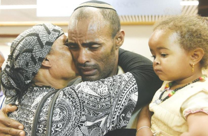 ETHIOPIAN IMMIGRANTS are greeted by loved ones at Ben-Gurion Airport. (photo credit: AVI HAYOUN)