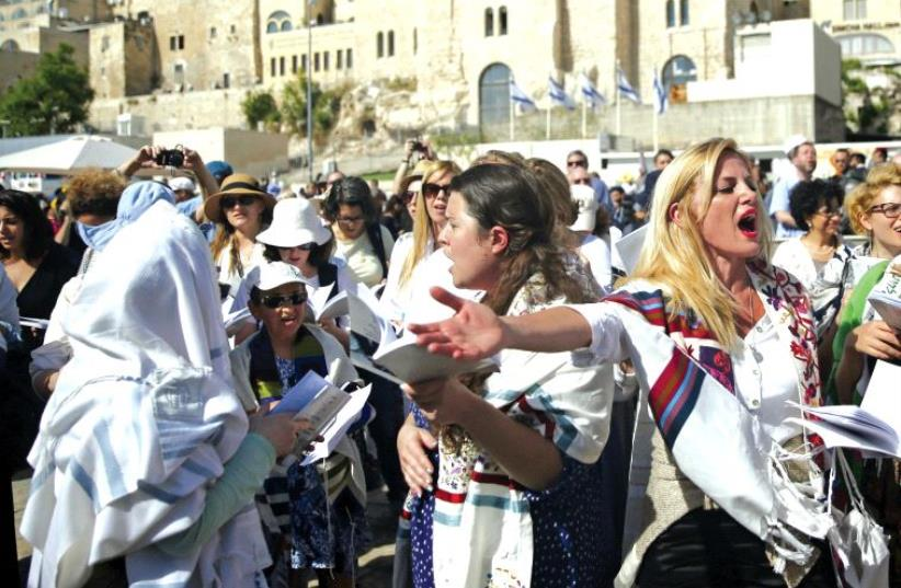 """Members of the """"Women of the Wall"""" wear Jewish prayer shawls which the Orthodox Jewish community traditionally reserves for men, during Passover near the Western Wall last April (photo credit: REUTERS)"""