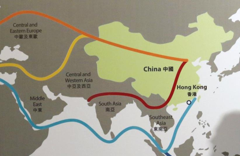 THE SHADOW of a participant is seen on a map illustrating China's 'One Belt, One Road' megaproject at the Asian Financial Forum in Hong Kong earlier this year. (photo credit: REUTERS)