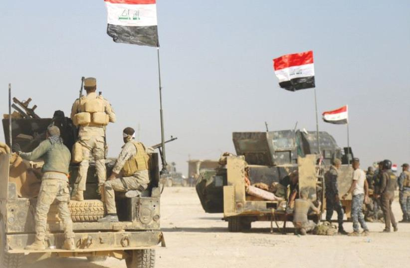 IRAQI FORCES advance in Qayara to attack Islamic State in Mosul (photo credit: REUTERS)