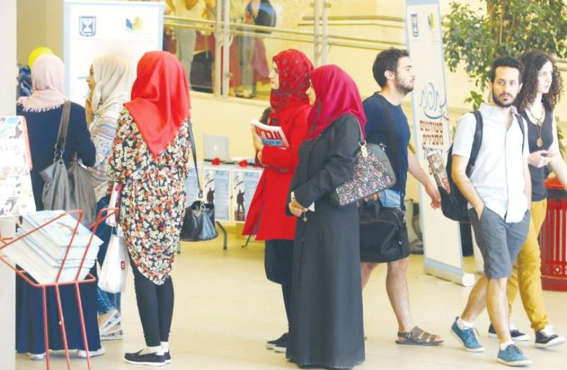 HEBREW UNIVERSITY of Jerusalem students report for the first day of classes last year. (photo credit: MARC ISRAEL SELLEM/THE JERUSALEM POST)