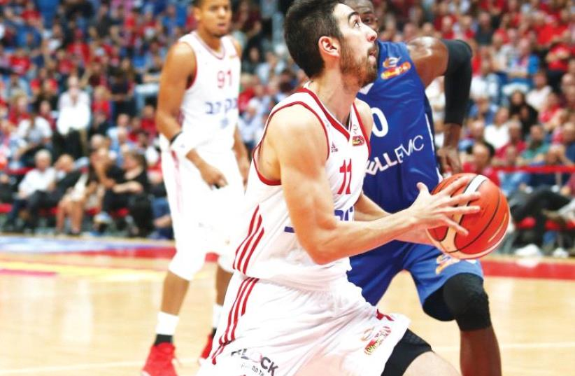 Hapoel Jerusalem guard Bar Timor aims to build on his impressive play in BSL action when the team visits Valencia tonight in its Eurocup regular-season opener. (photo credit: DANNY MARON)