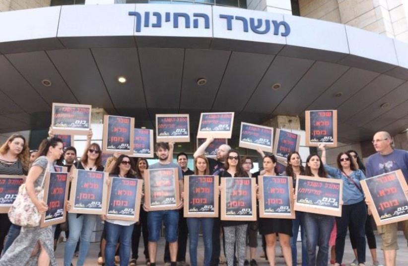 Teachers protest outside of the Education Ministry in Tel Aviv (photo credit: AVSHALOM SASSONI)