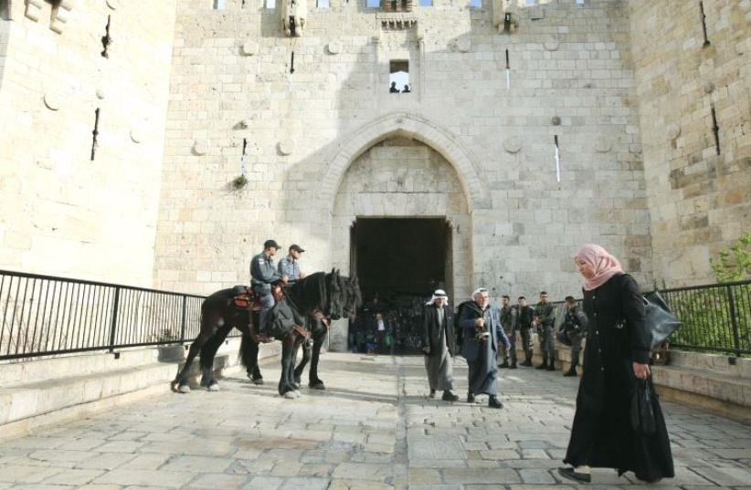 Border police and local Arabs at Jerusalem's Damascus Gate in the Old City (photo credit: MARC ISRAEL SELLEM)