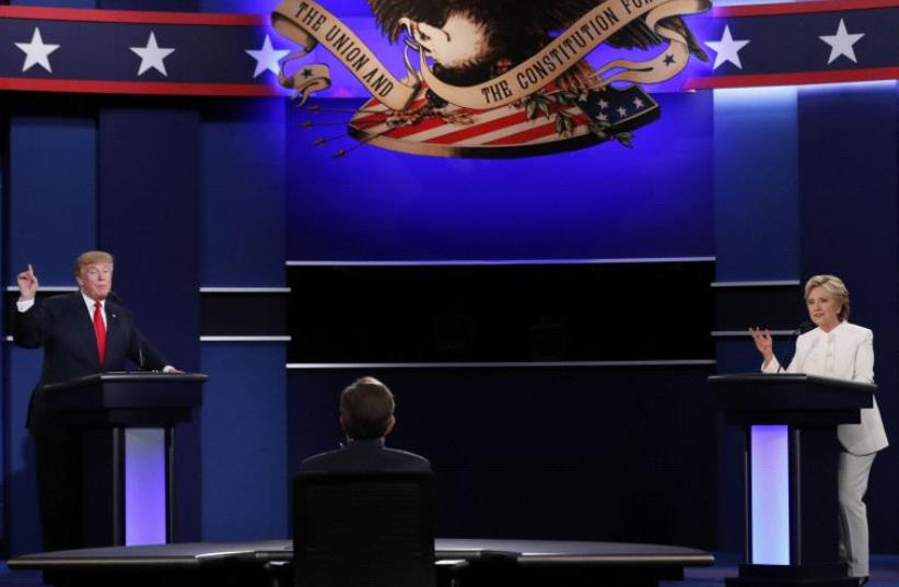 Republican US presidential nominee Donald Trump and Democratic US presidential nominee Hillary Clinton take part in their third and final 2016 presidential campaign debate in Las Vegas, Nevada, October 19, 2016 (photo credit: REUTERS)