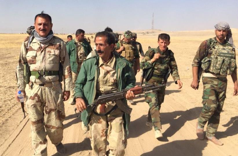 Kurdish peshmerga forces on the way to Mosul (photo credit: SETH J. FRANTZMAN)